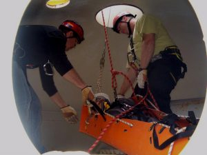 Rescue Technician Extracts Victim from Confined Space using SKED.
