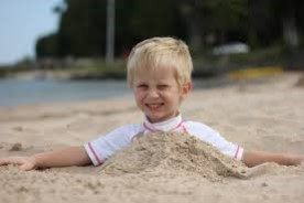 Being partially buried by loose sand is a beach-going tradition but not the same as being subjected to a cave-in.