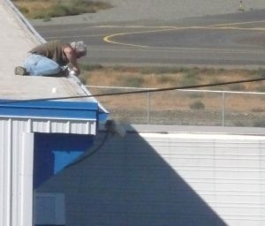 Worker too close to a roof edge.