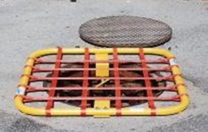 Temporary manhole cover to protect the confined space attendant from falls.