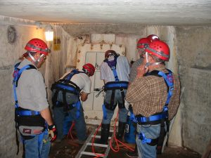 An on-site confined space rescue team preparing to enter the scroll case of a hydroelectric dam.