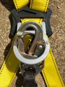 Snap-hook falsely engaged with a harness D-ring.